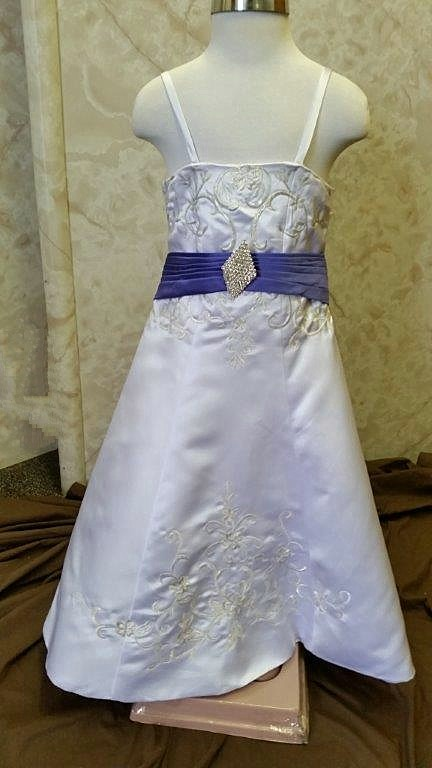 White wedding gown with purple waistline and train
