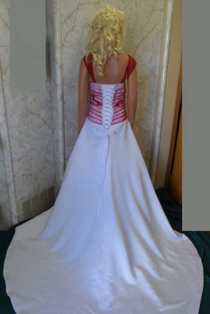 White wedding gown with apple red overlay