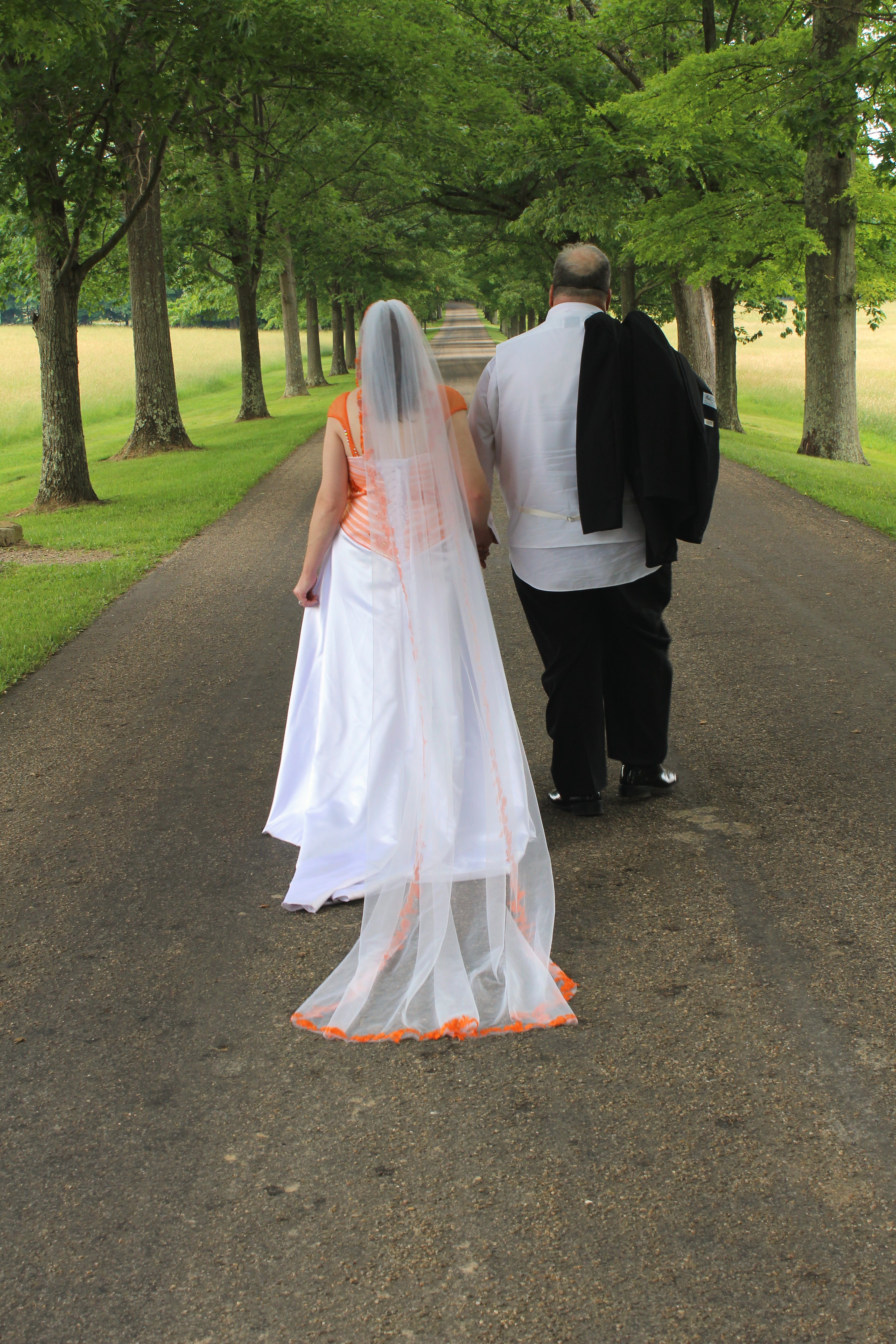 white and orange wedding dress and veil
