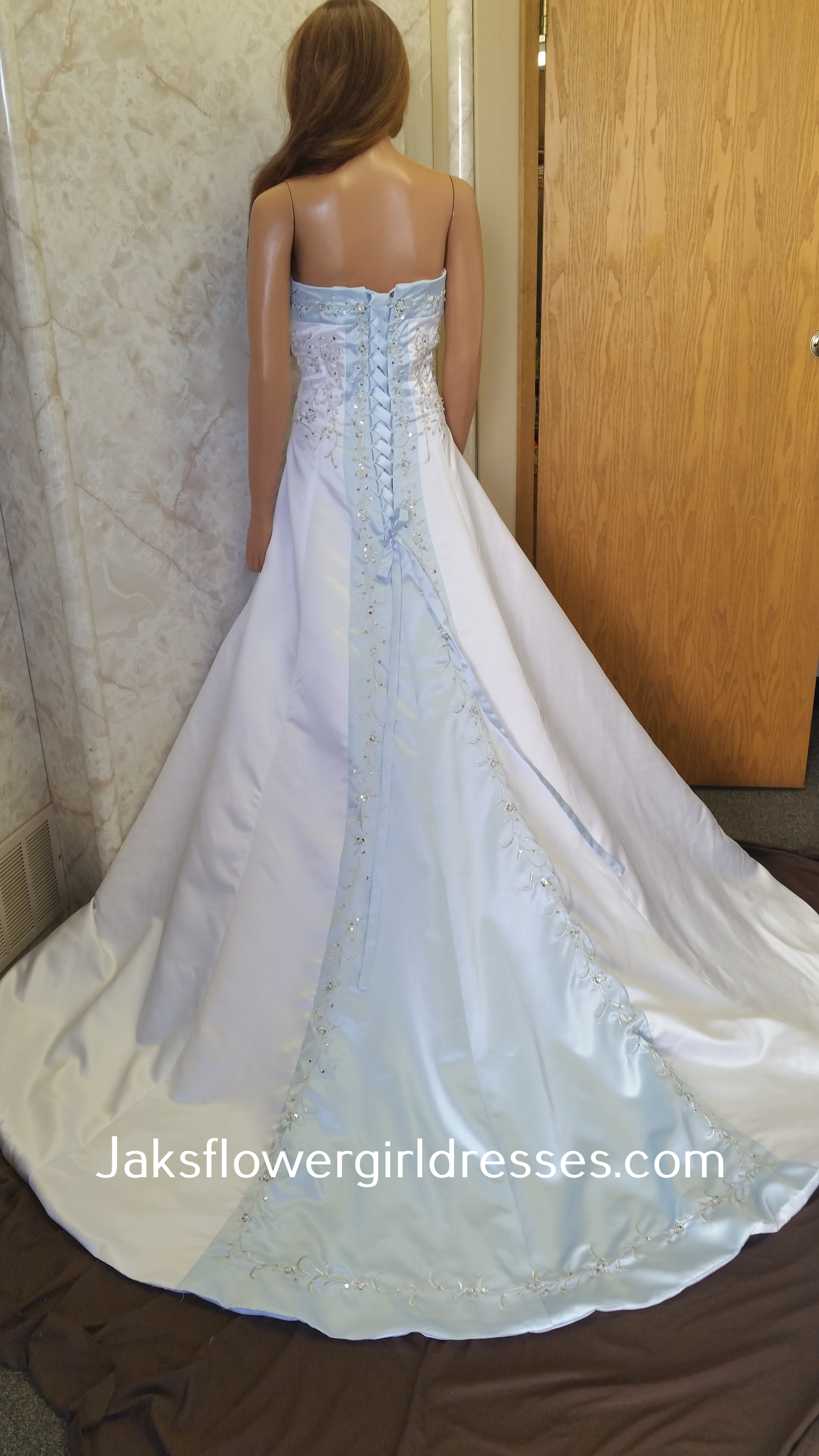 white and light blue wedding gown