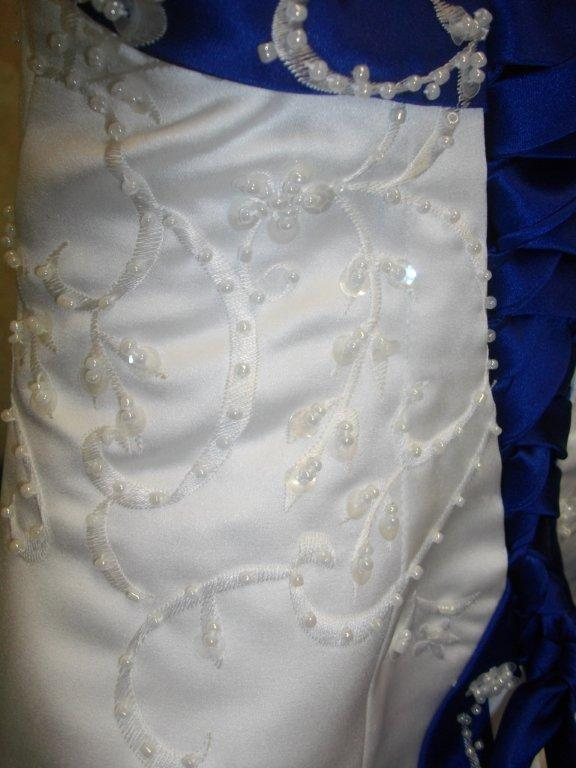 royal blue and white embroidery on wedding gown