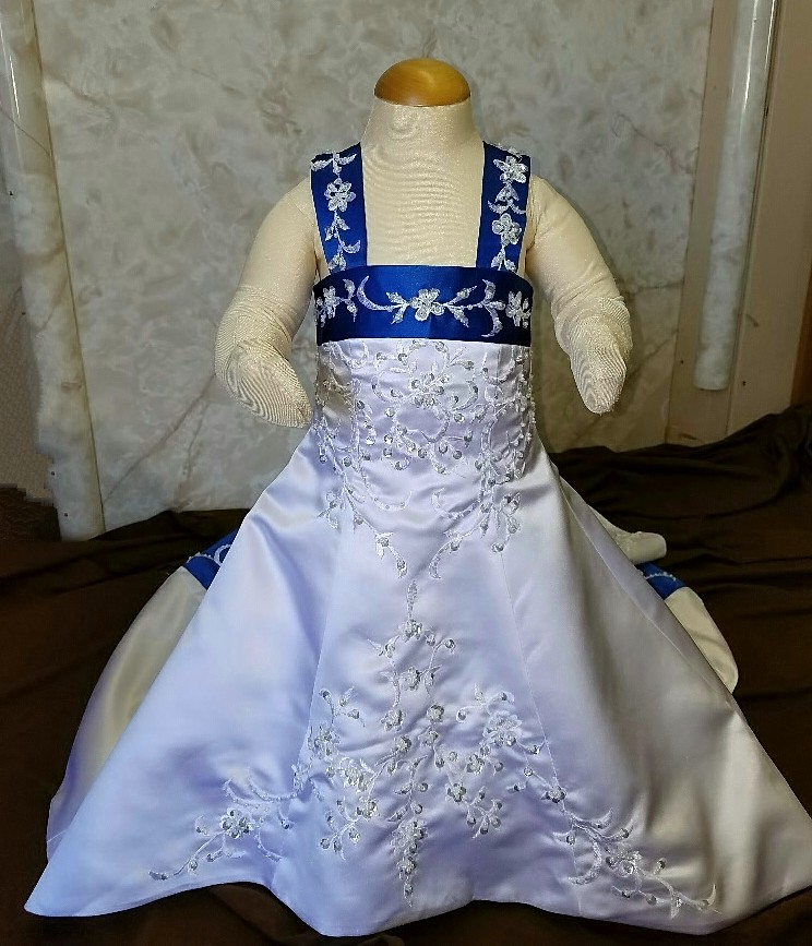 infant wedding dress in white and royal blue