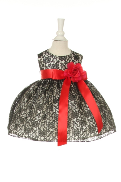 black lace dress with red sash and flower