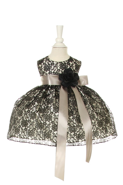 black lace dress with silver sash and black flower