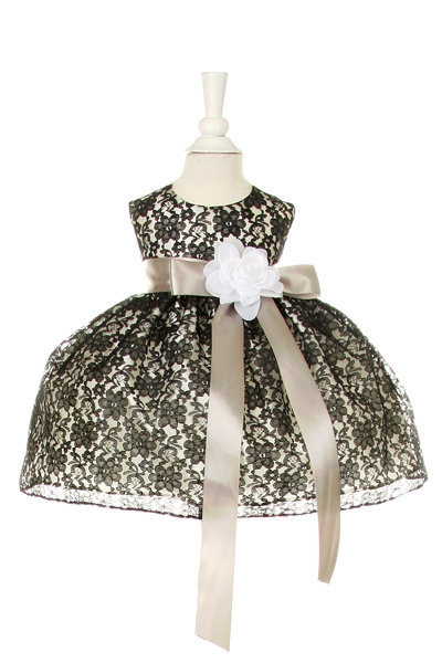 black lace dress with silver sash and white flower