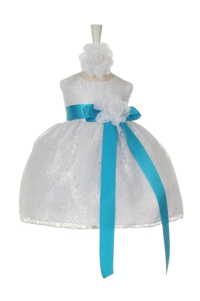 white dress with turquoise sash