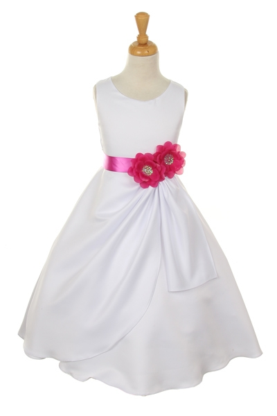 white dress with magenta flower sash