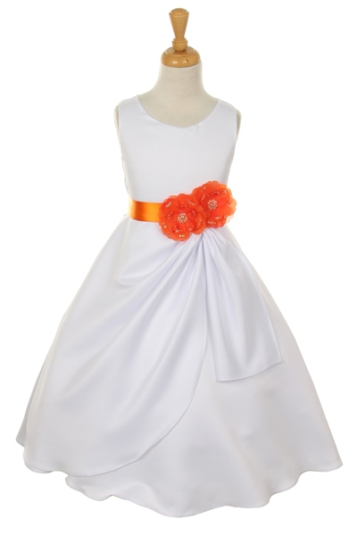 white dress with orange flower sash