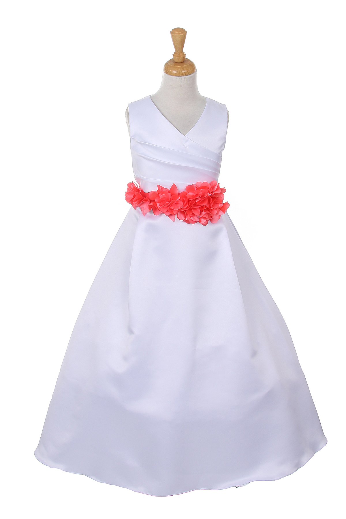 white dress with coral flower sash
