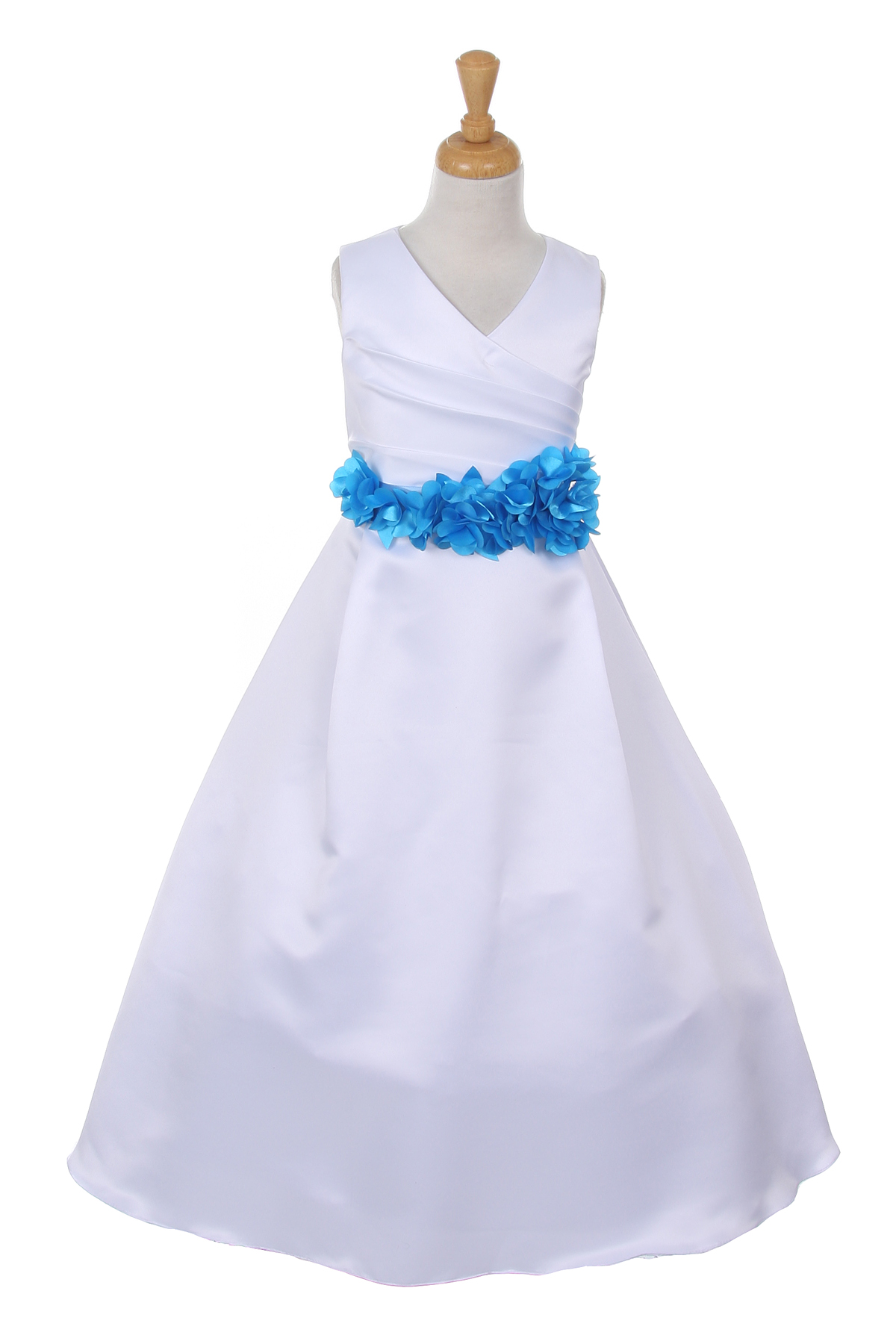 white dress with turquoise flower sash