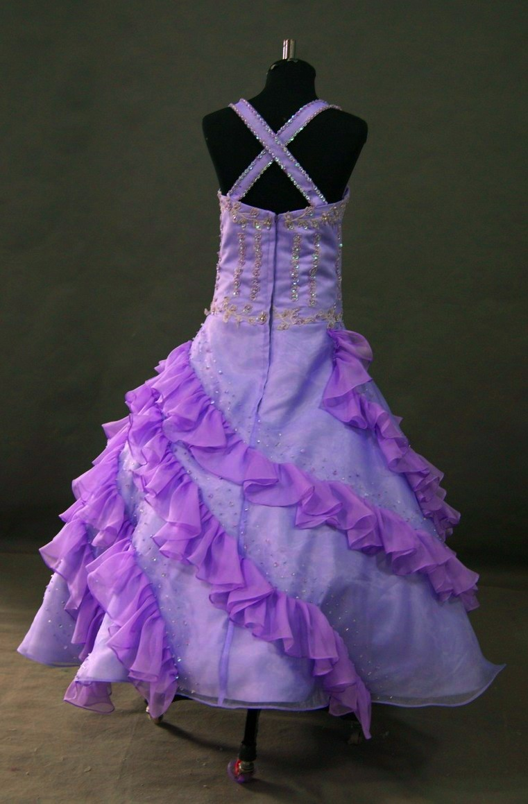 purple pageant dress with ruffled skirt