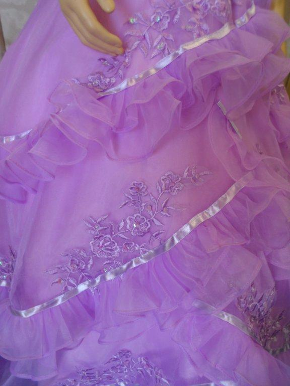 crisscross layers of pleated organza with beadwork skirt