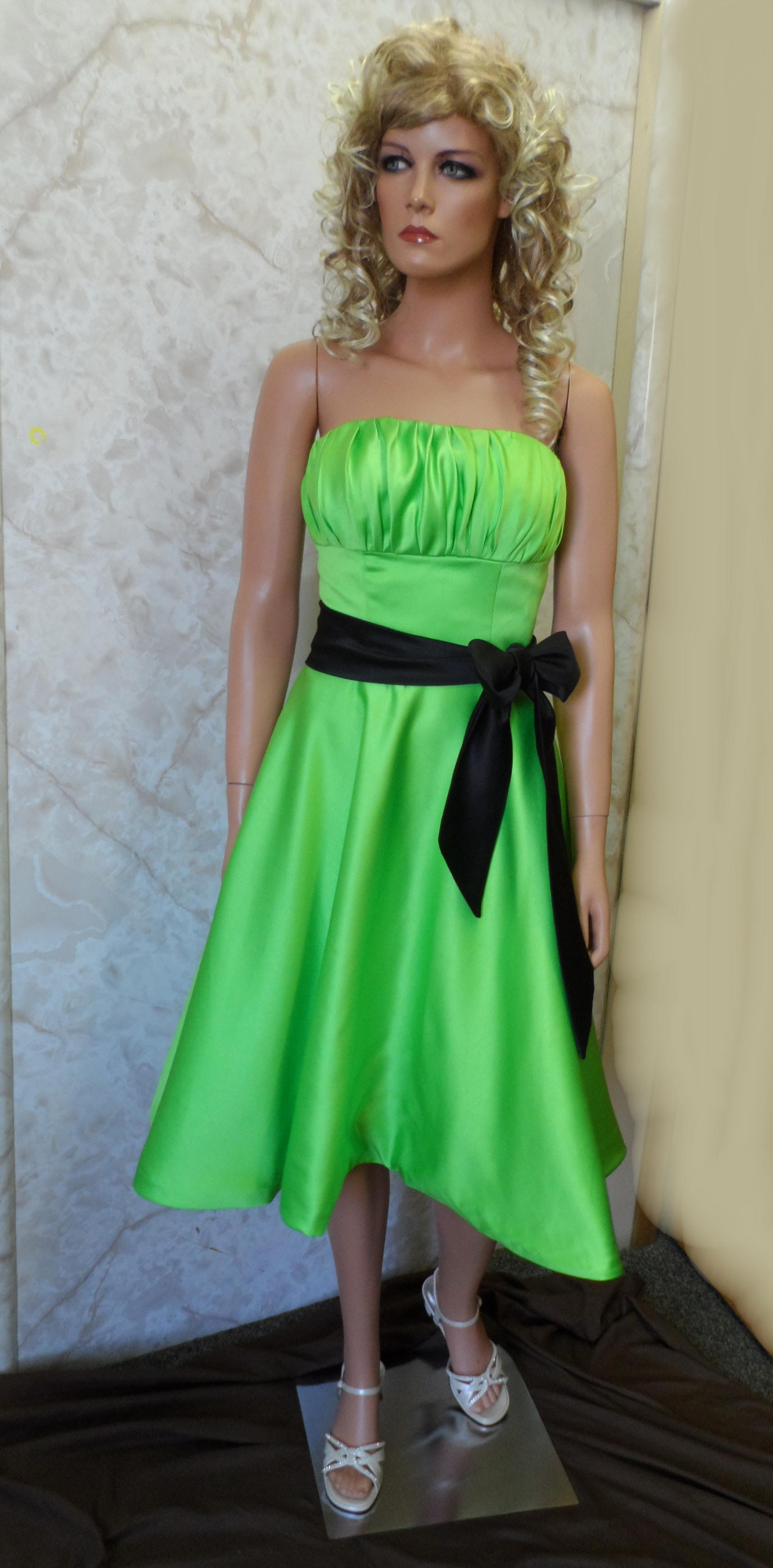 Lime green strapless dress with black sash