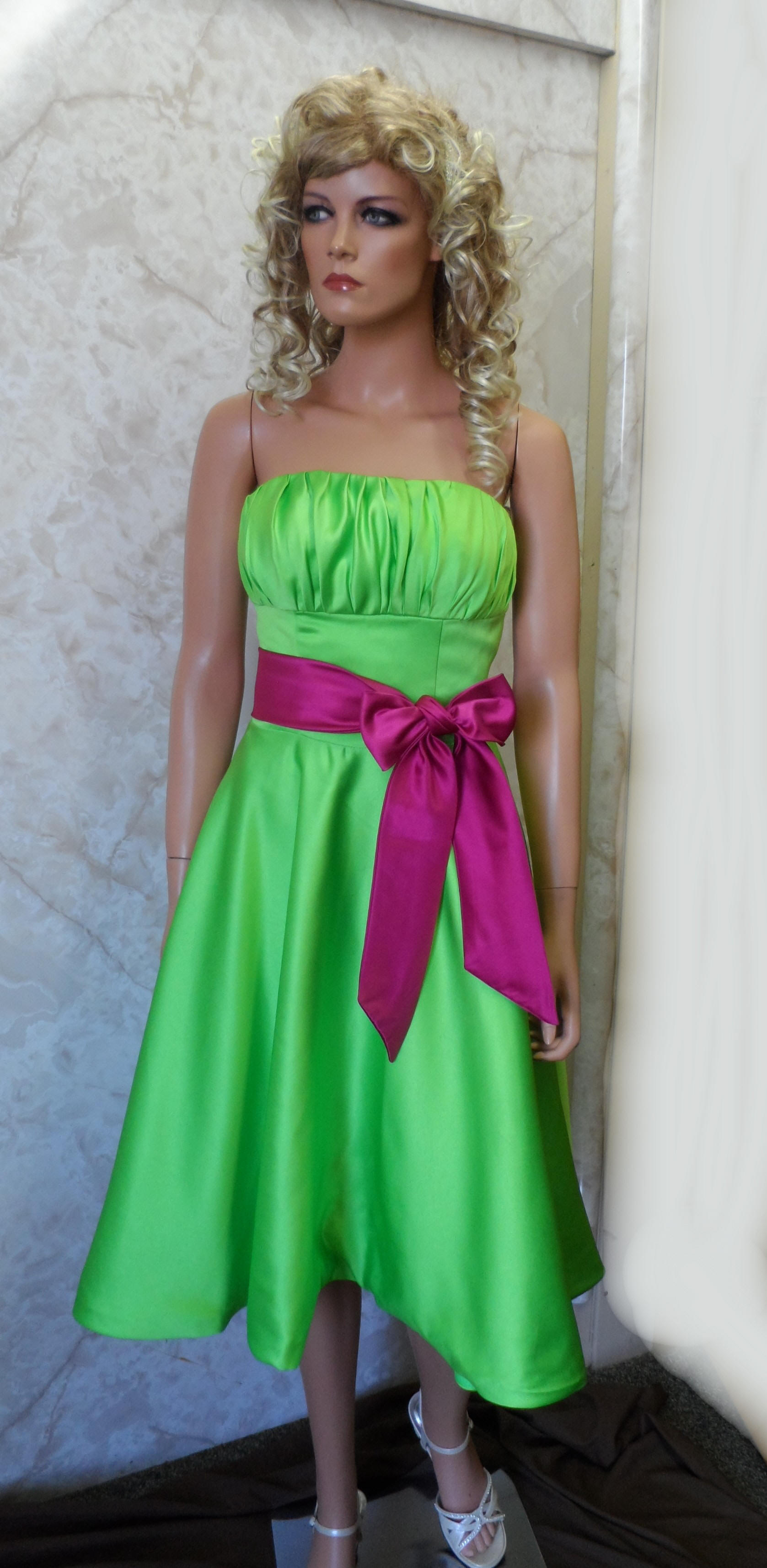 Lime green strapless dress with fuschia sash