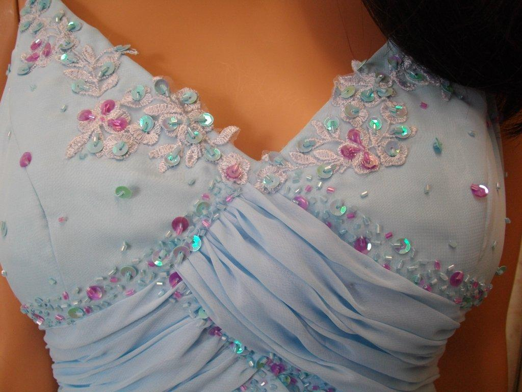 Bodice and pleated waistline is accented with light purple and blue sequins and beading