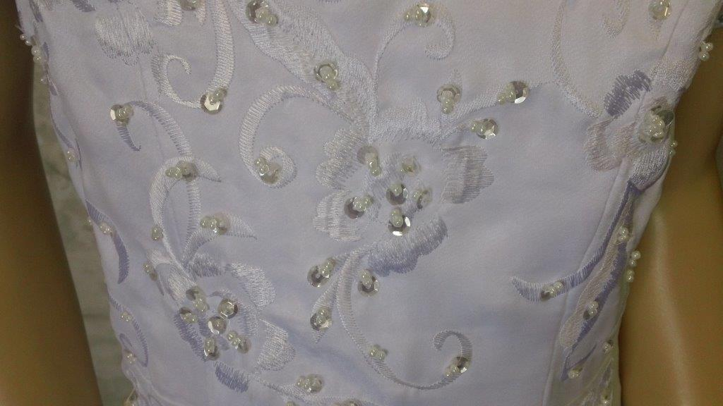 sequin and beading on embroidered bodice