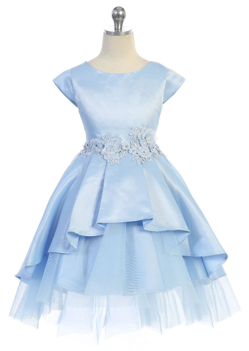 Cap sleeve dress with high low peplum and tiered tulle underlay.