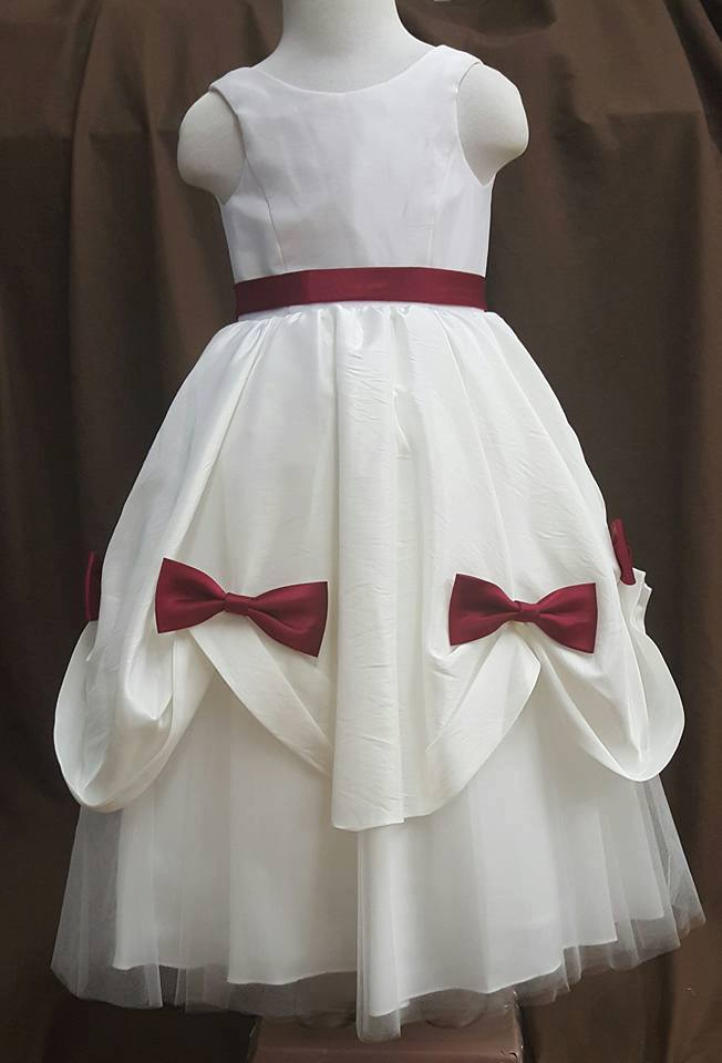 ivory dress with apple red sash