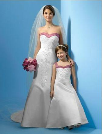 bride with matching flower girl dresses