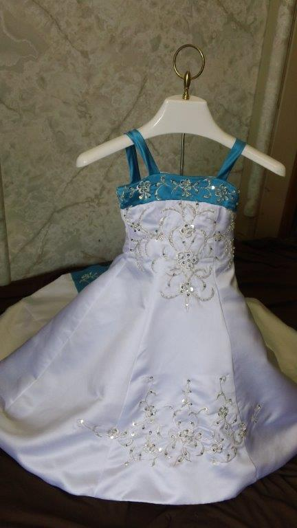white and turquoise wedding gown with matching infant dress