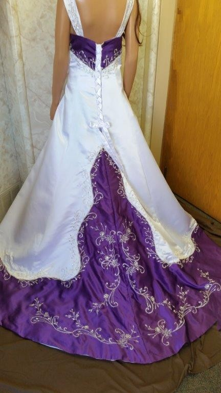 white and purple wedding gown