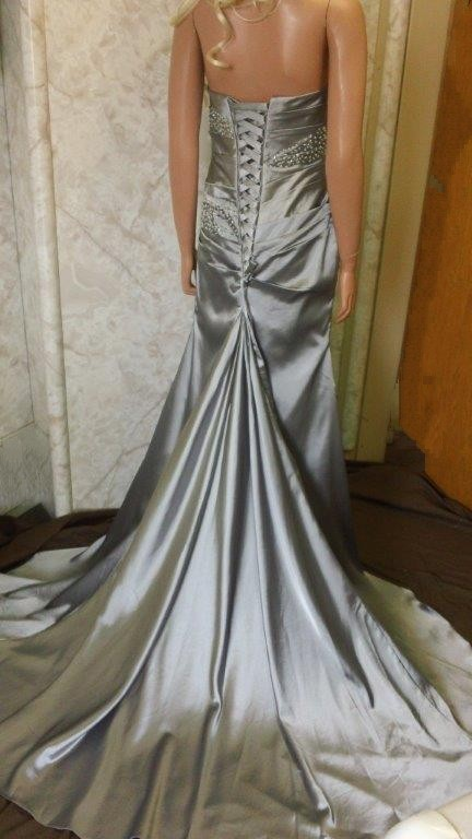 silver strapless fish tail prom dress