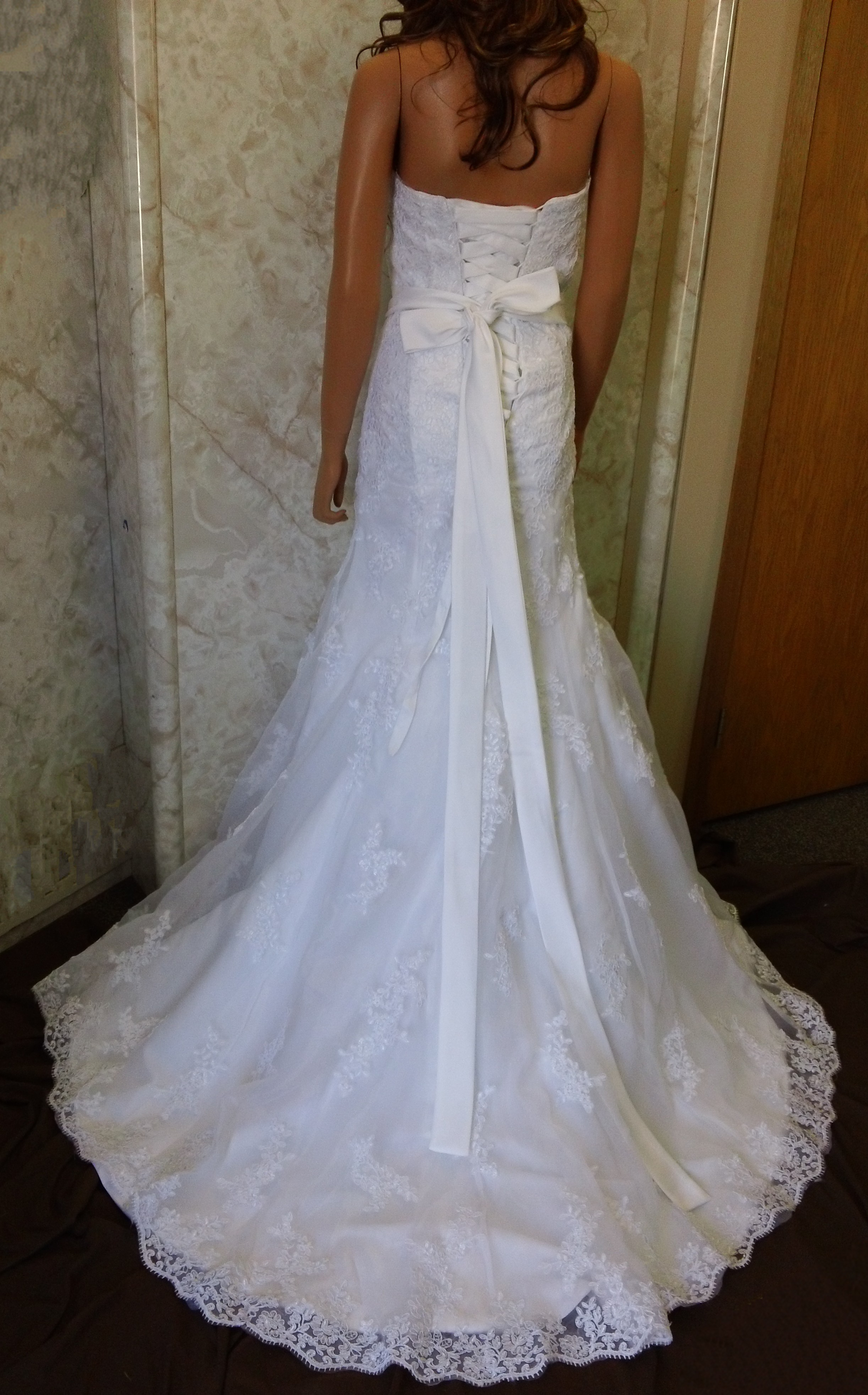 white lace fit and flare wedding gown