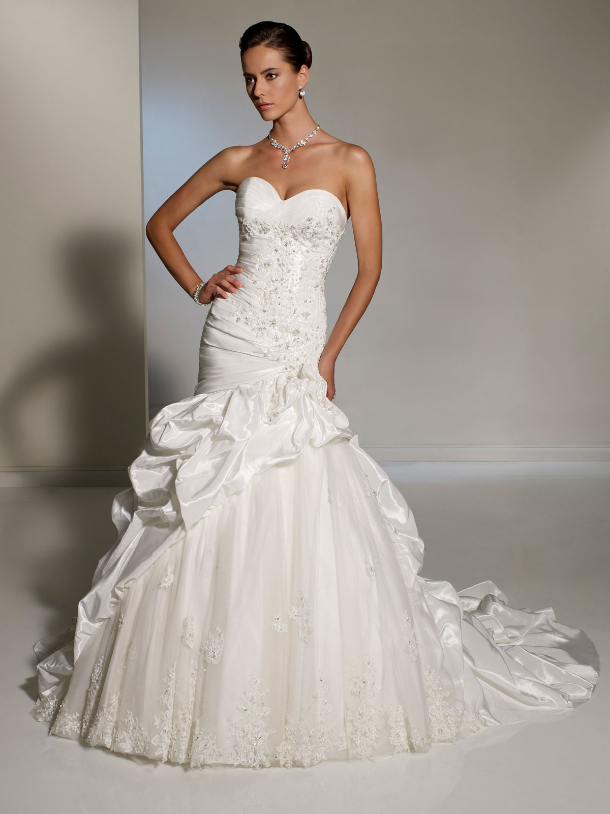 Fitted wedding dresses with pick up skirt and cascading pick up train