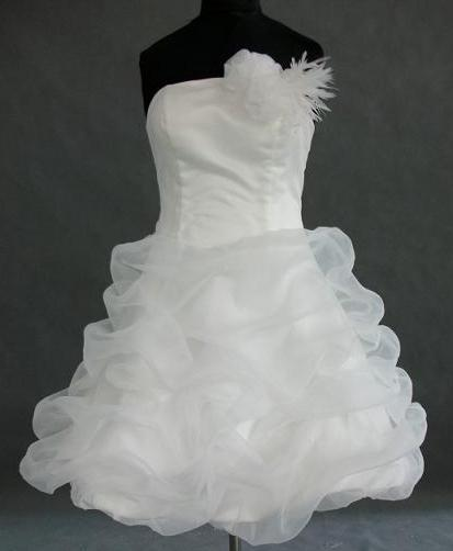 strapless feathered dress with fitted bodice and short pickup skirt