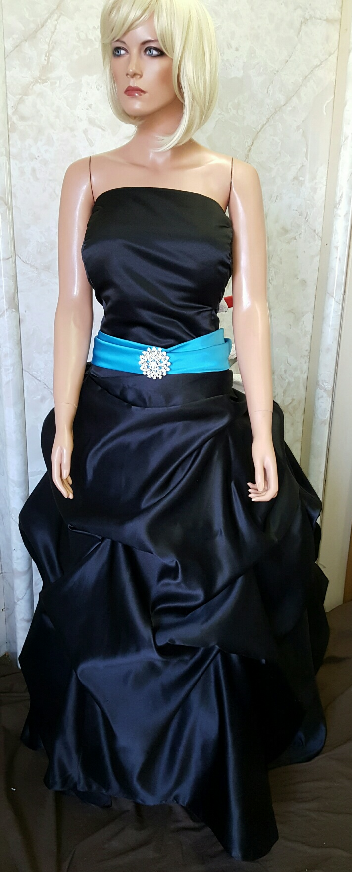 Black dress with turquoise sash