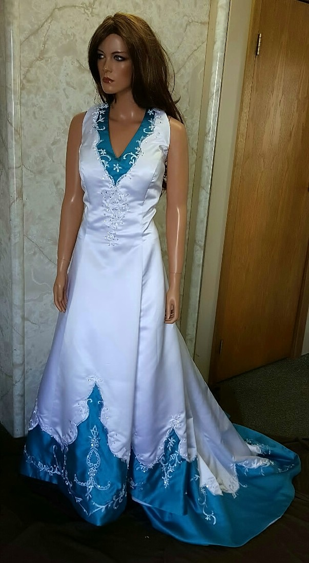 white and turquoise wedding gown