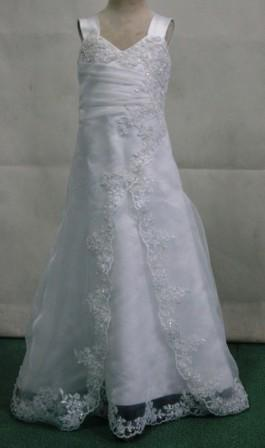 Miniature bridal gown with lace appliques.