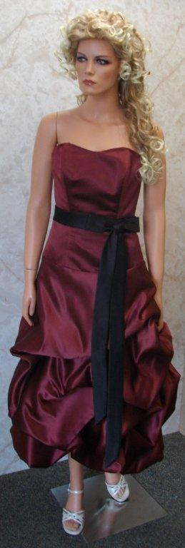 Bridesmaid wearing a merlot tea length dress with black sash