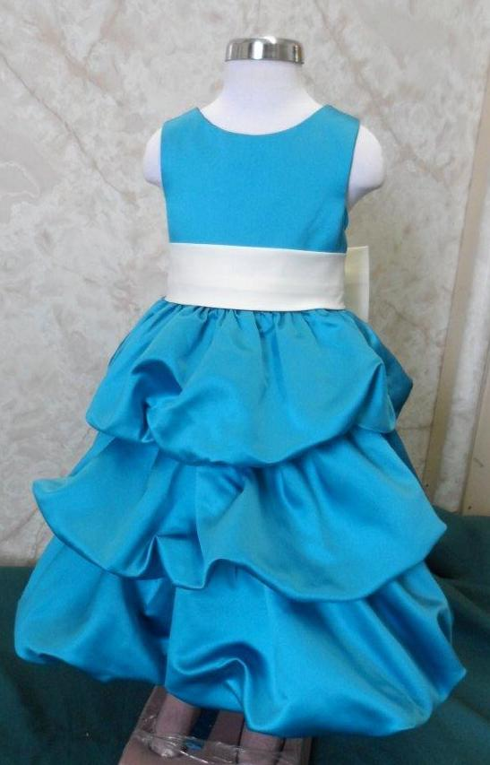 Turquoise bubble dress with ivory back bow sash