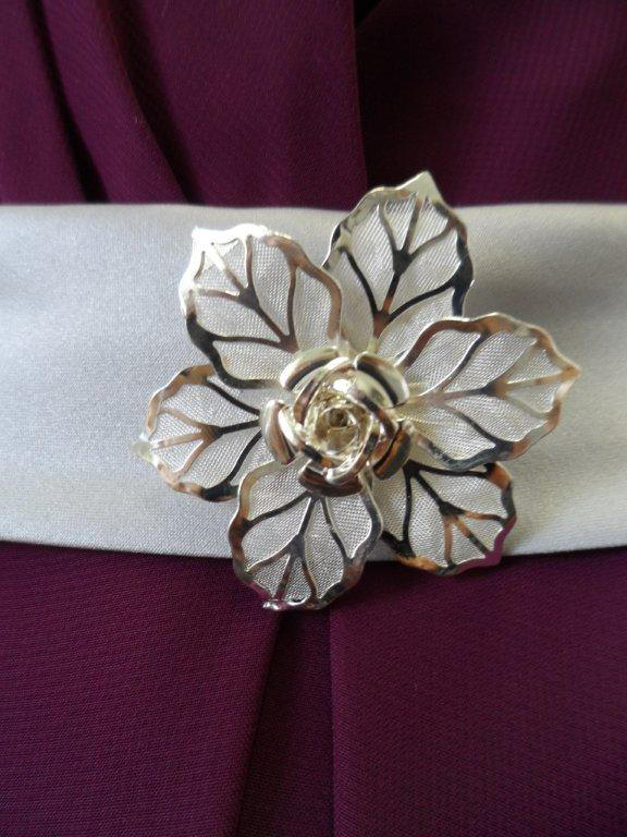 Waistline is adorned with a broach