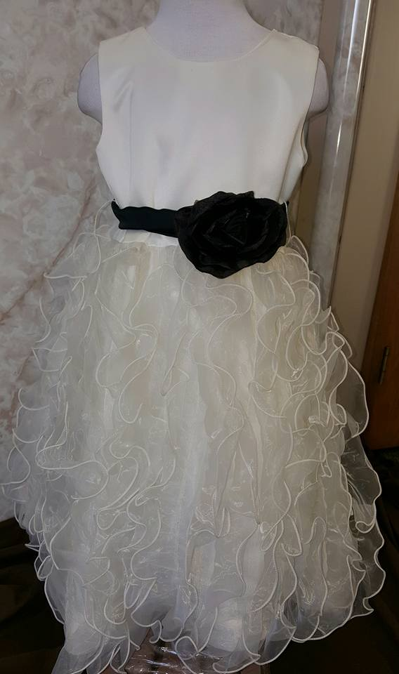 ivory ruffle dress with black sash