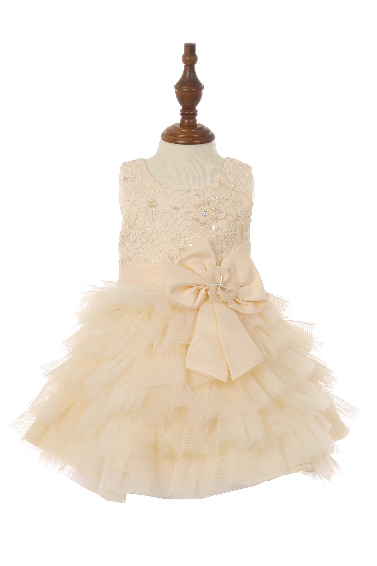 Baby dress with bow, and rows of ruffles