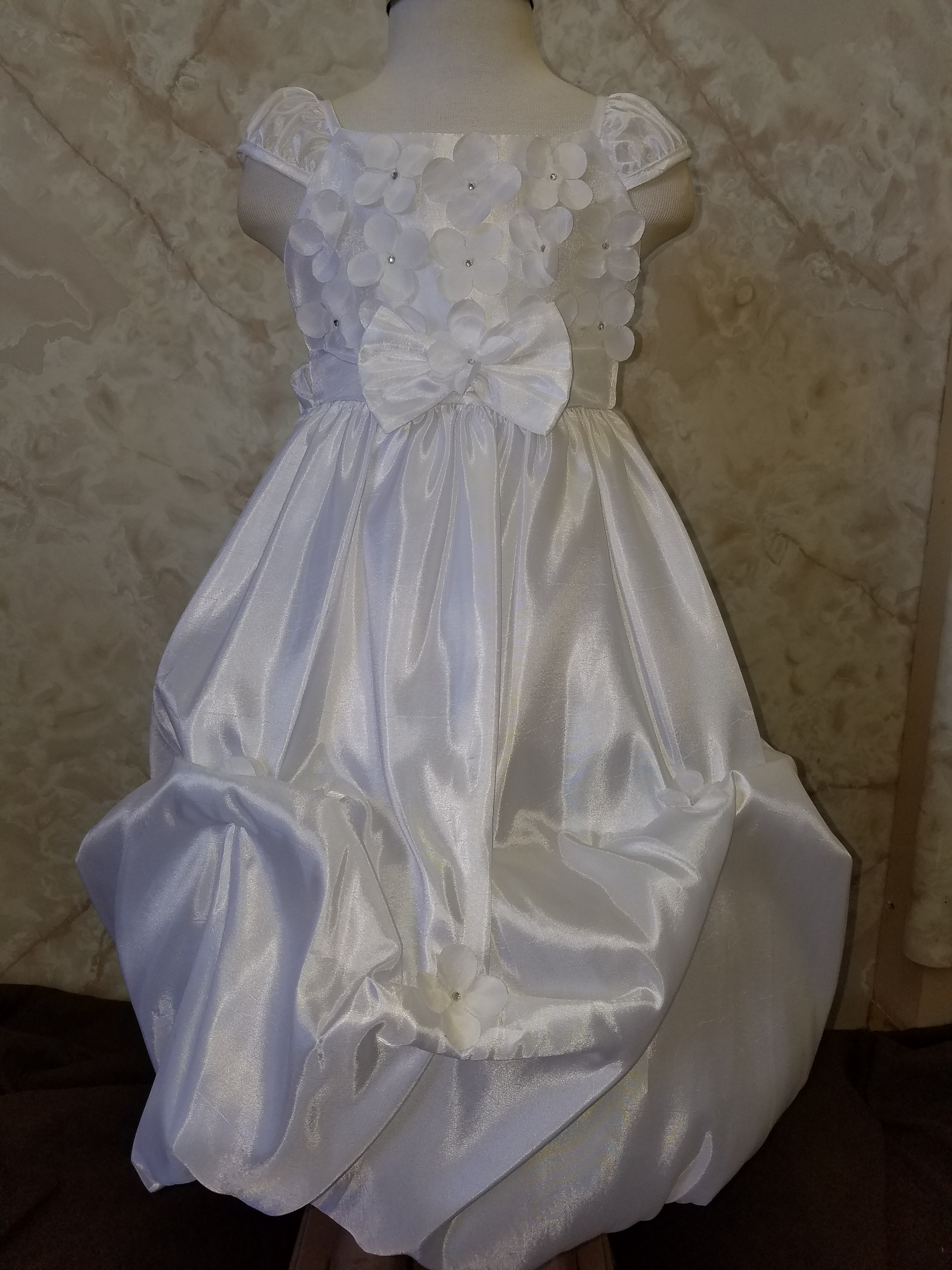 white dress with flowers on bodice