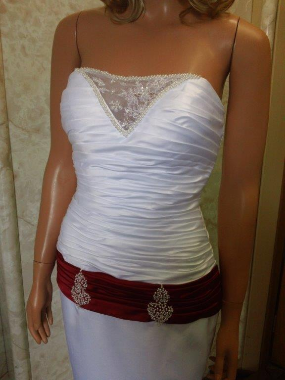white wedding gown with red dropped sash