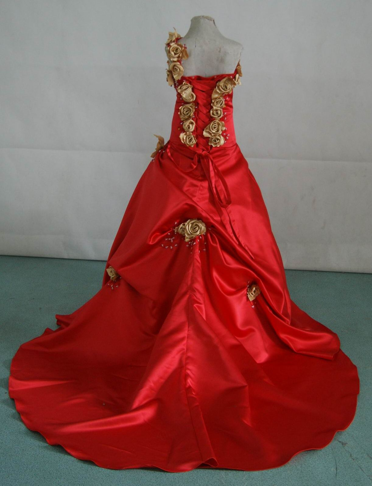 red ballgown with gold rose strap