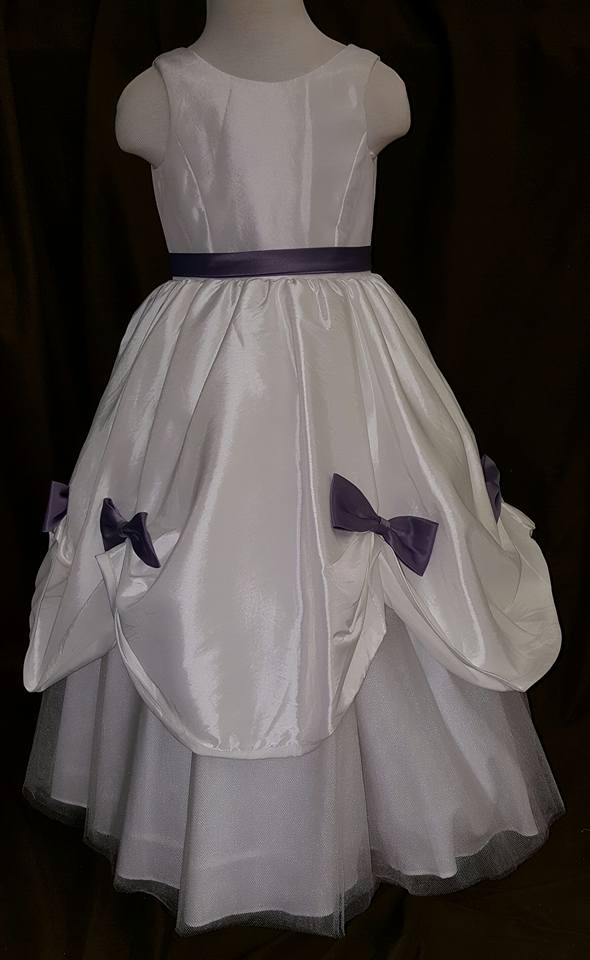 white dress with removable purple bows and sash