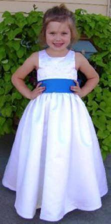 white dress with blue sash