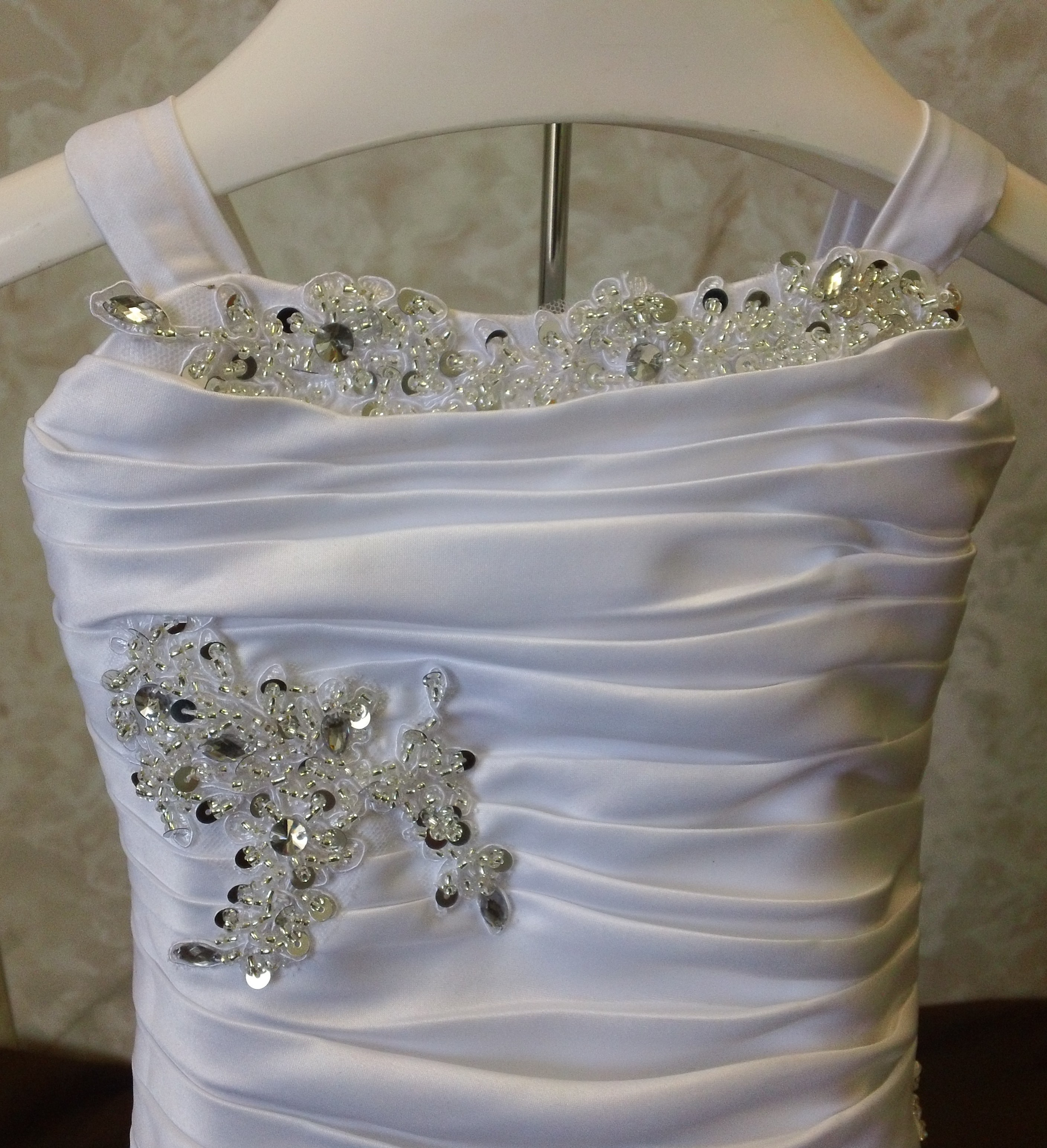 ruched bodice with beaded applique
