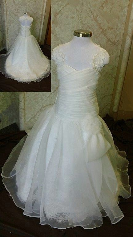 ruched gown with large flower accent