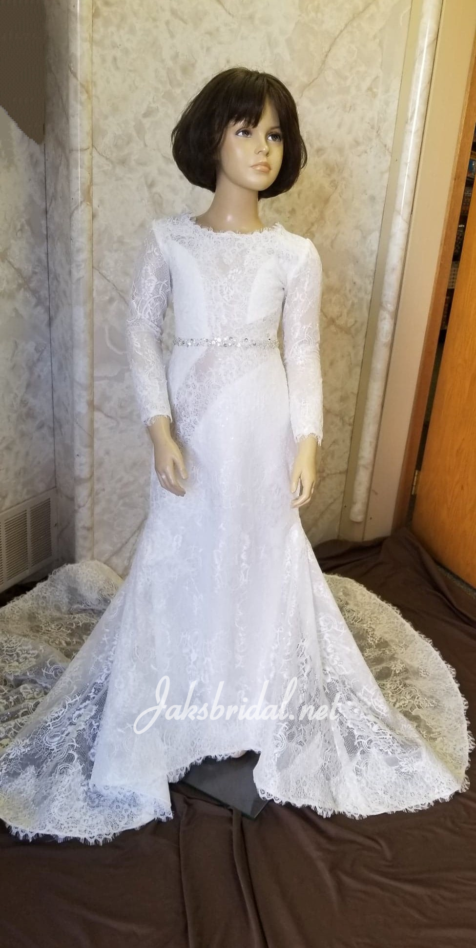 Long sleeve flower girl dress, sprinkled with sequins. Lace illusion sleeves, neck, back and train