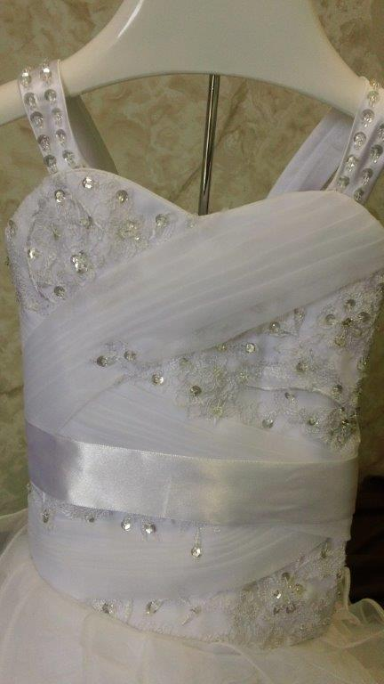 lace appliques across bodice flowing down to the skirt