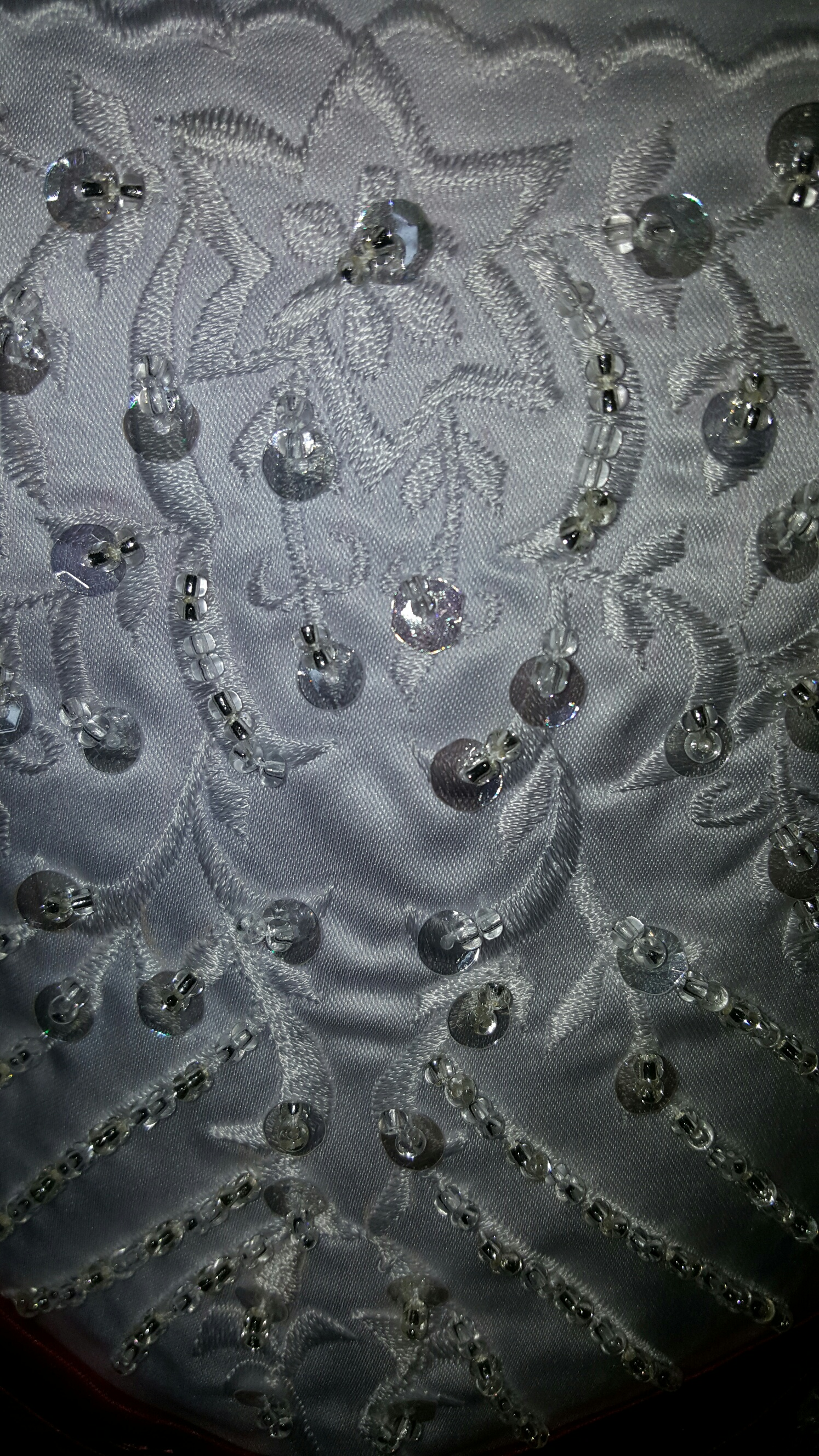 white embroidery with silver and clear beading