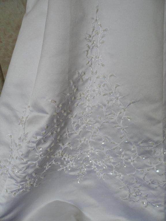 white embroidered skirt of miniature wedding gown