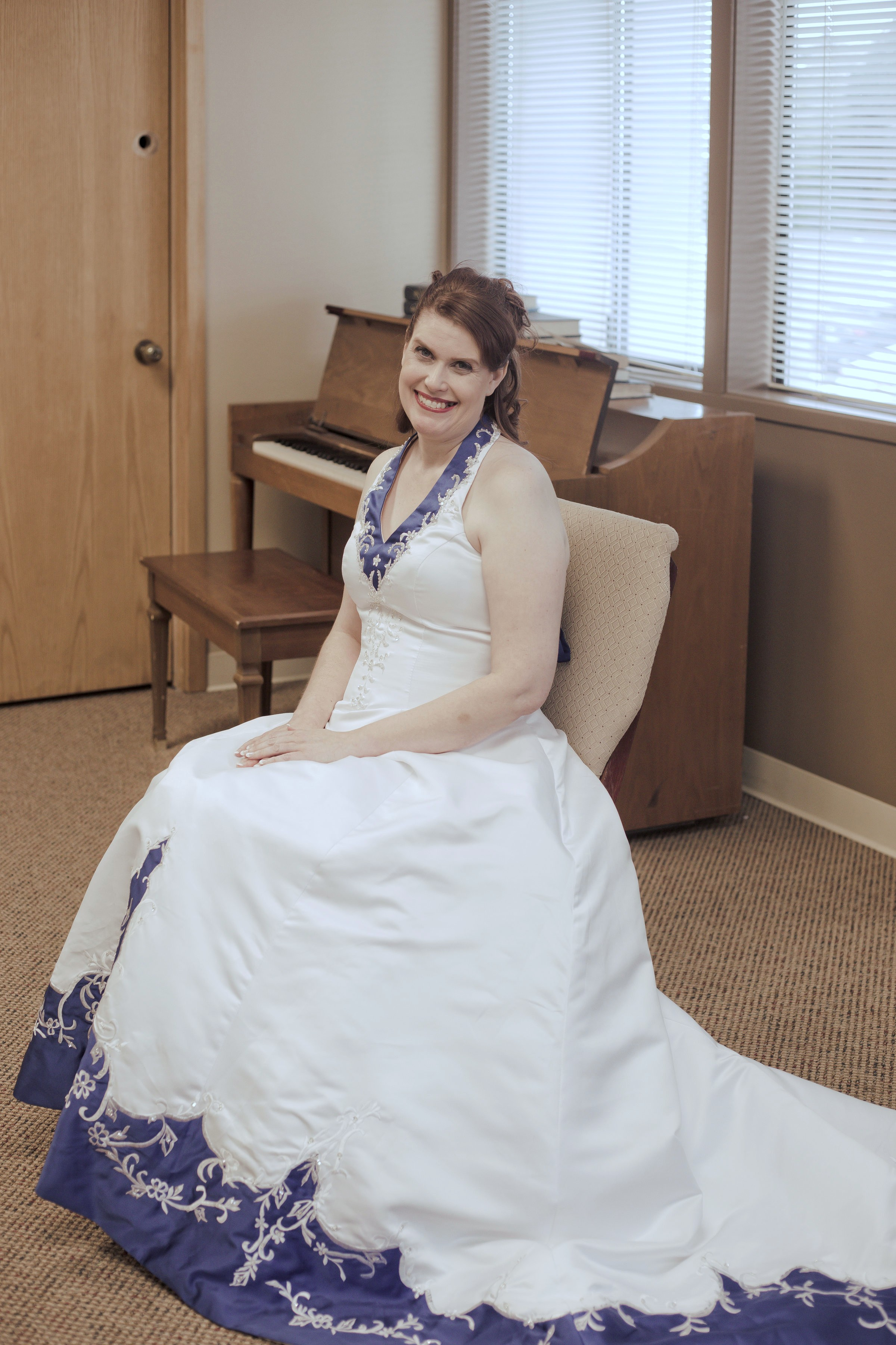 bride is wearing royal blue and white