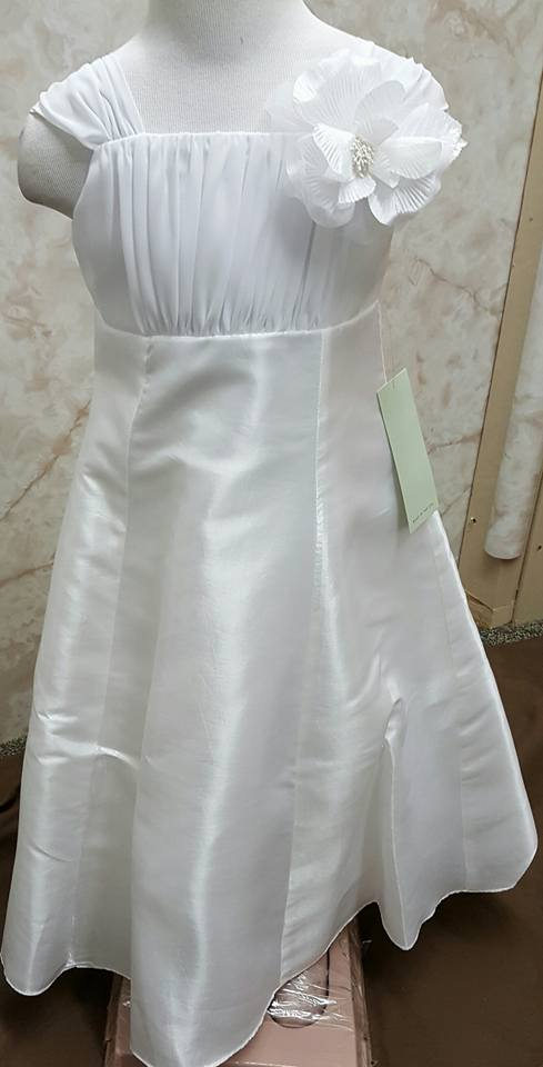 white dress with white flower on the shoulder strap